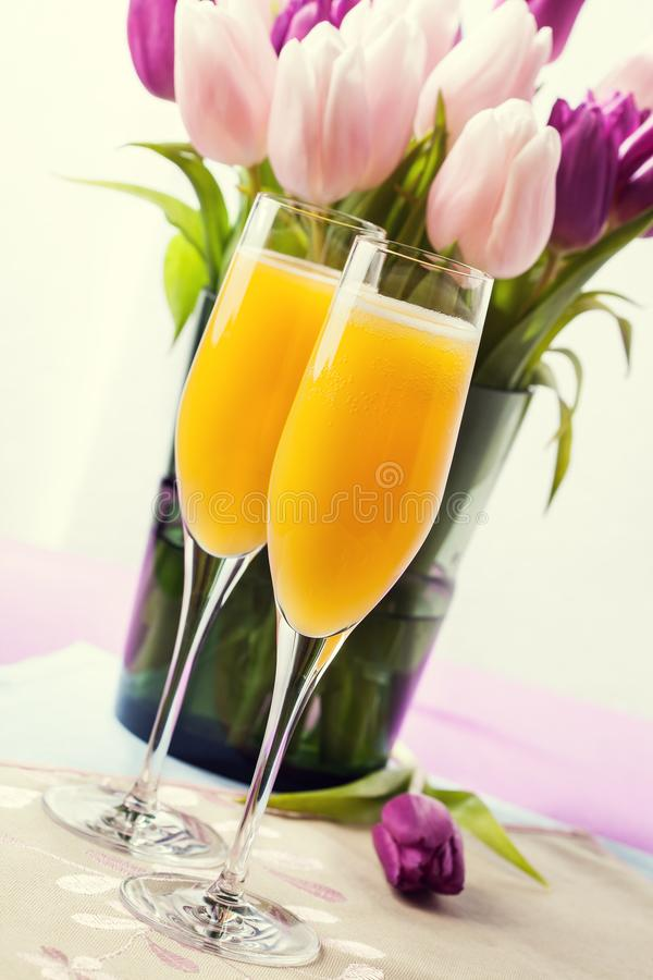Two glasses of mimosa cocktail stock photography