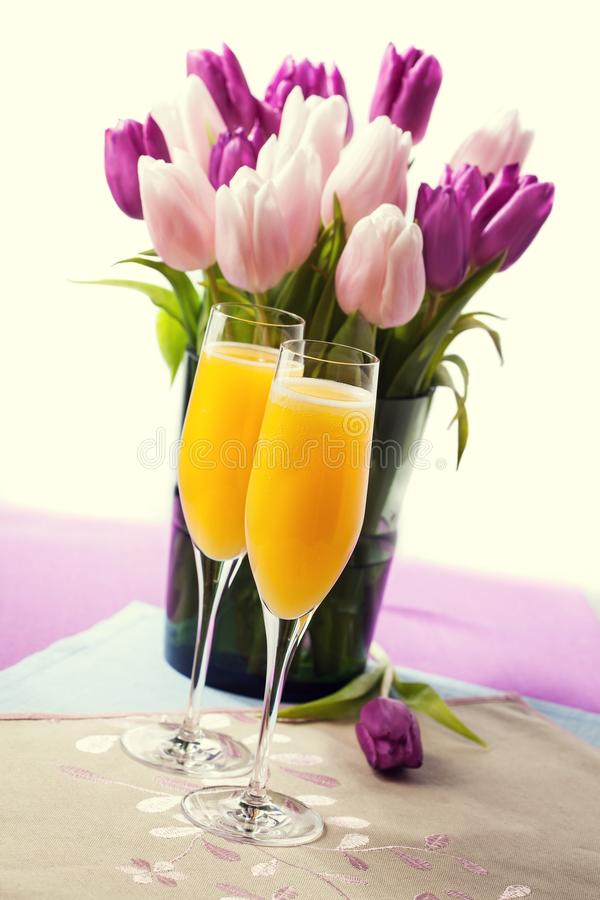 Two glasses of mimosa cocktail royalty free stock photography