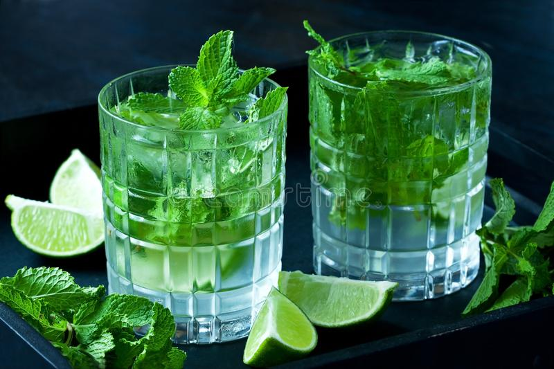 Mojito alcoholic cocktail on black wooden background. royalty free stock photos