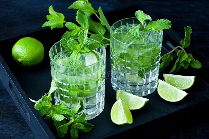 Mojito cocktail, iced drink with lime and mint stock photos