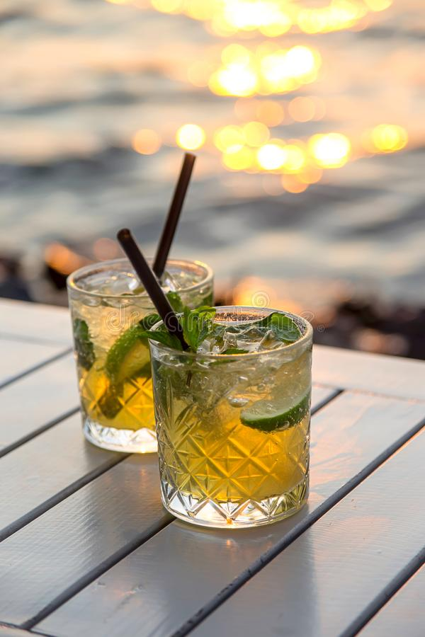 Serving mojito in a street cafe as a summer vacation royalty free stock photos