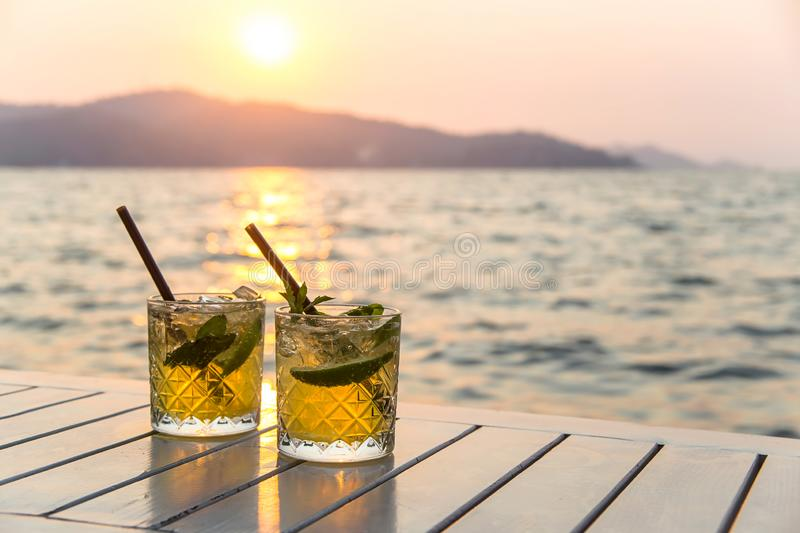 Serving mojito in a street cafe as a summer vacation royalty free stock photography