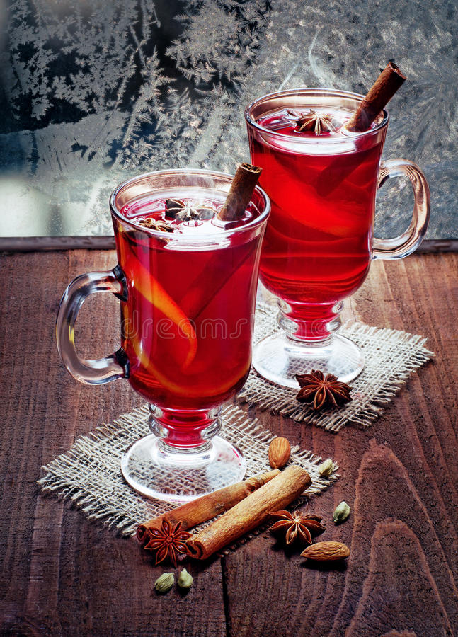 Two glasses of mulled wine on old wooden table stock photography