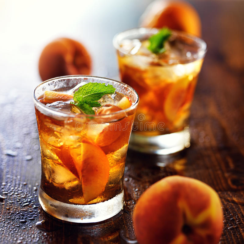 Free Two Glasses Of Sweet Peach Iced Tea Stock Photos - 50315953