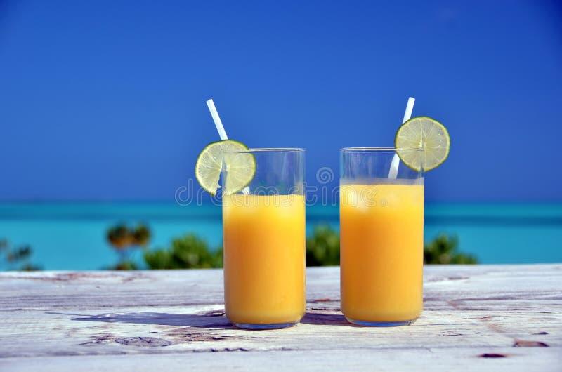 Two glasses of orange juice stock photo