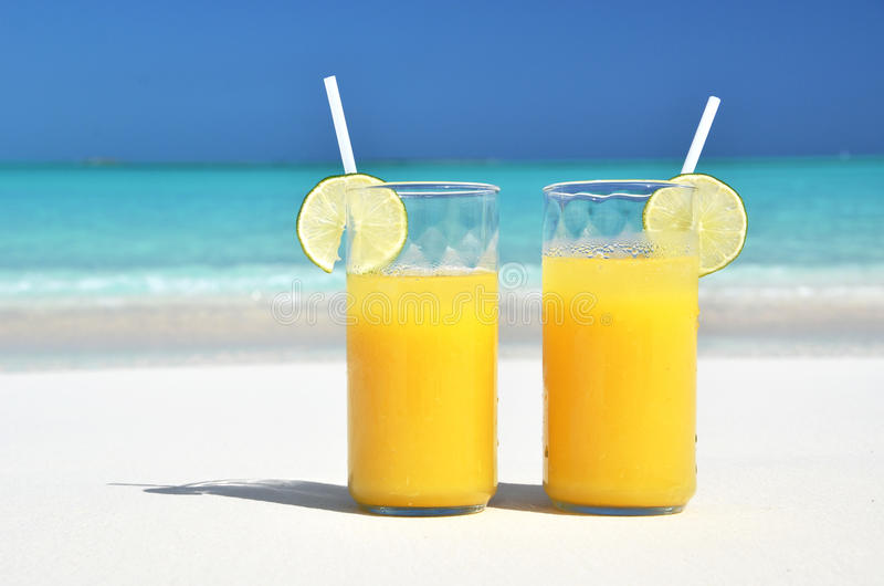 Two glasses of orange juice stock photography