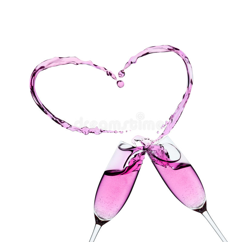 Two glasses of pink champagne with a splash. In the shape of a heart stock photography