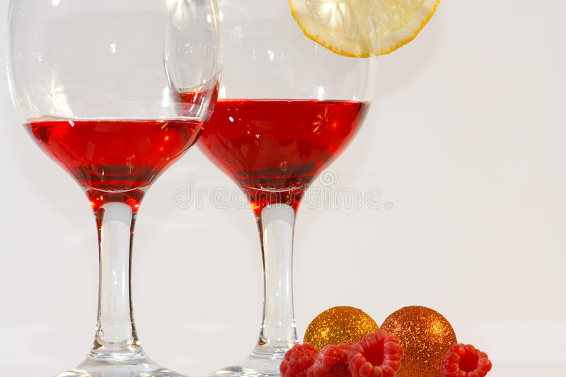 Two Glasses Of Red Liquor, Lemon And Raspberries Royalty Free Stock Photo