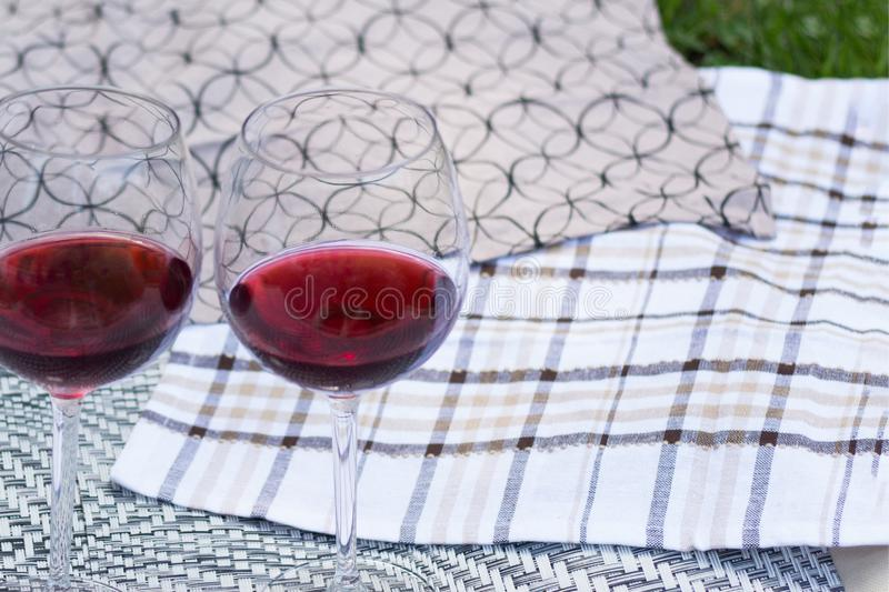 Two glasses with red wine on a beautiful tablecloth. Top view of alcoholic drink. Two glasses with red wine on a beautiful tablecloth. Top view, closeup of stock image