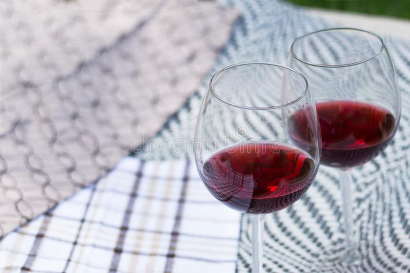 Two glasses with red wine on a beautiful tablecloth. Top view of alcoholic drink. Two glasses with red wine on a beautiful tablecloth. Top view, closeup of stock photo