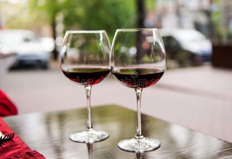 Two glasses with red wine royalty free stock photos