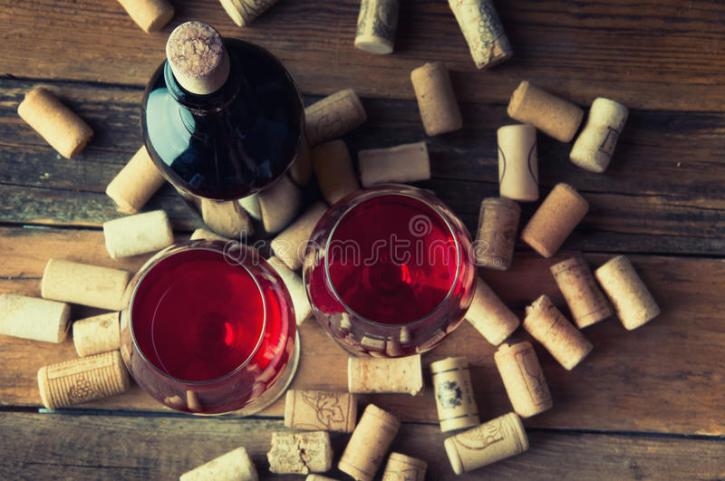Two glasses of red wine and corks. Copyspace. Top view stock images