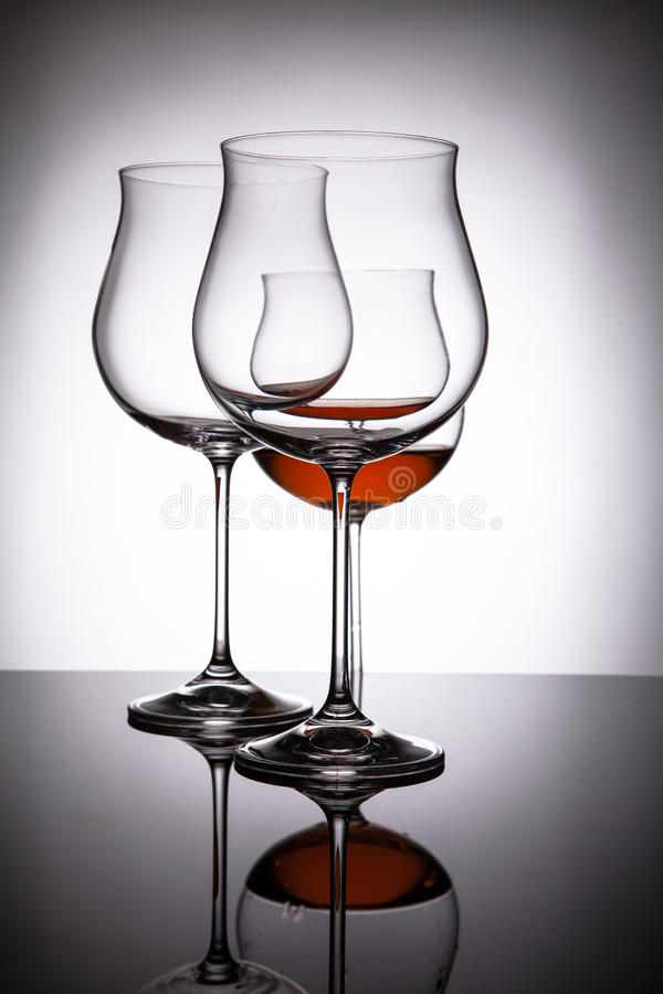 Download Two Glasses With Red Wine, Creating The Illusion Of Four Stock  Photo   Image