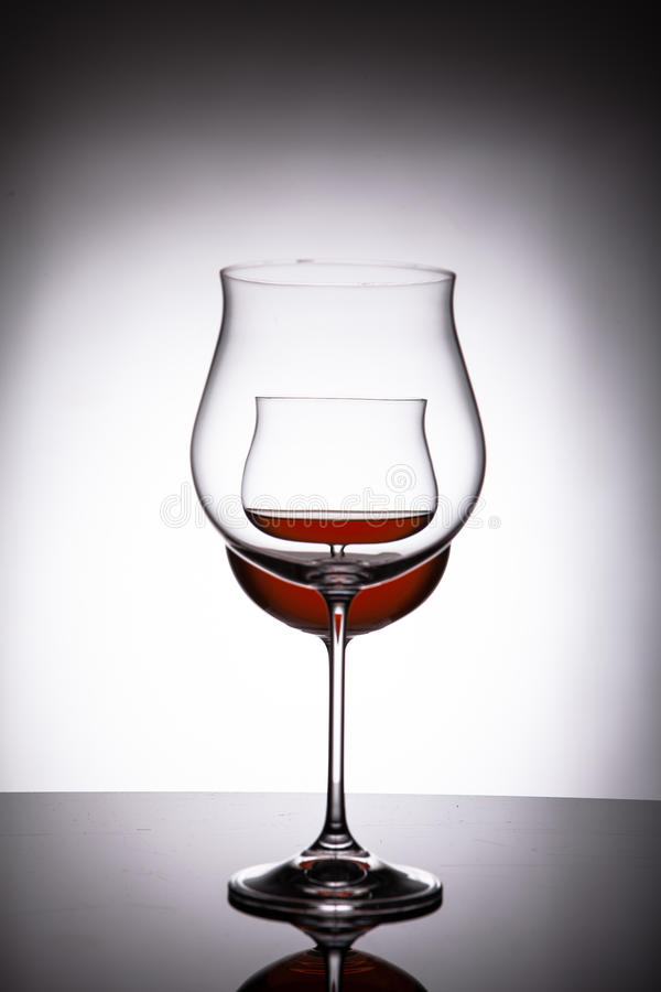 Download Two Glasses With Red Wine, Creating The Illusion Of Three Stock  Image   Image