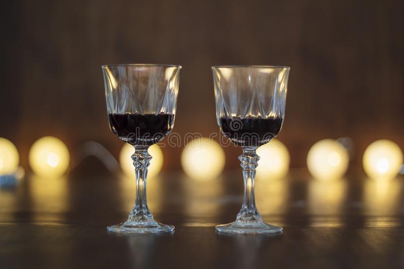 Two glasses of red wine on wooden table stock images
