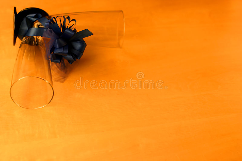 Two glasses and a ribbon royalty free stock image