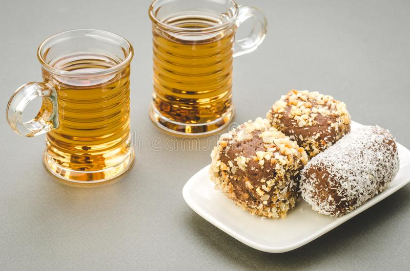 Two glasses of tea and cakes in a plate/two glasses of tea and c royalty free stock photography