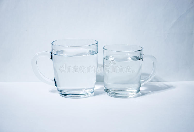 Two glasses of water. Light background royalty free stock photo