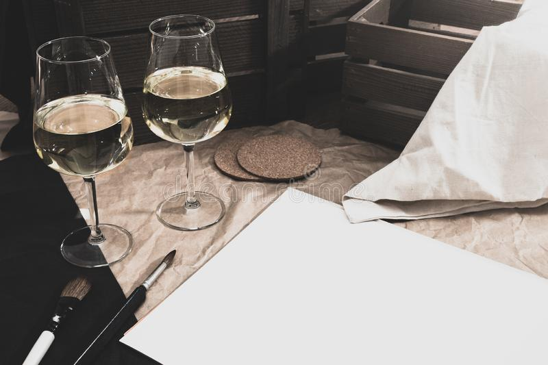 White wine and paint brushes royalty free stock photography