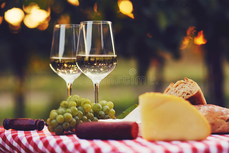 Two glasses of white wine at sunset stock images