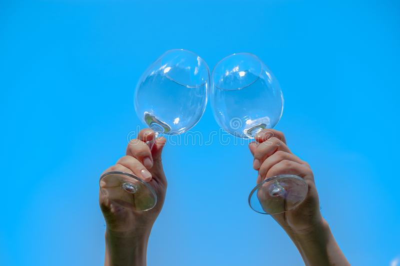 Two glasses of wine against the backdrop of the setting sun with space for text royalty free stock photography
