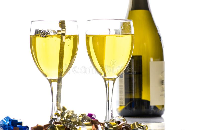 Two glasses with wine, champagne on the background of the bottle and tinsel. Two glasses with wine, champagne on the background of the bottle stock photo