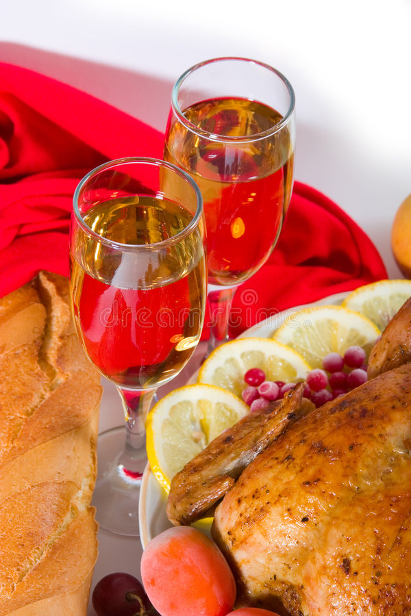 Two glasses of wine with dinner royalty free stock image