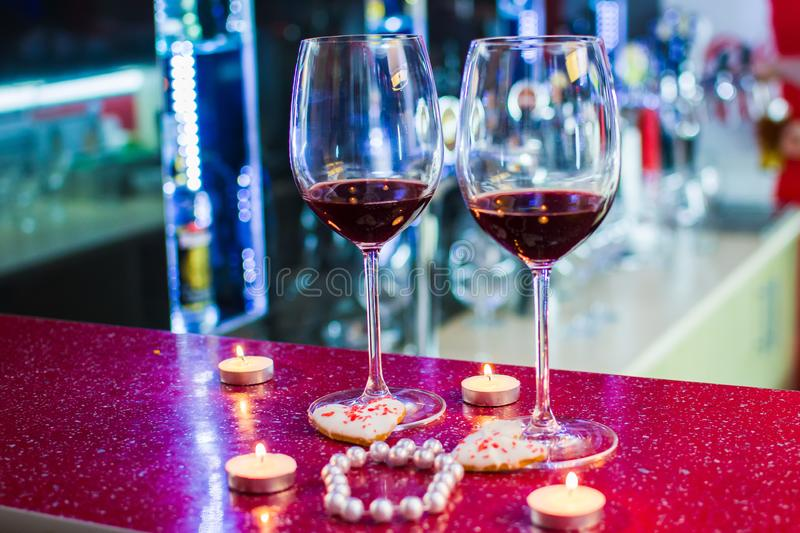 Two glasses of wine and heart-shaped cookies. Valentine`s Day.  royalty free stock photos