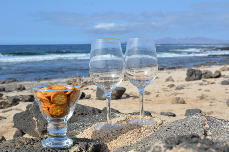 Two Glasses Of Wine On The Nice Tropical Beach royalty free stock images