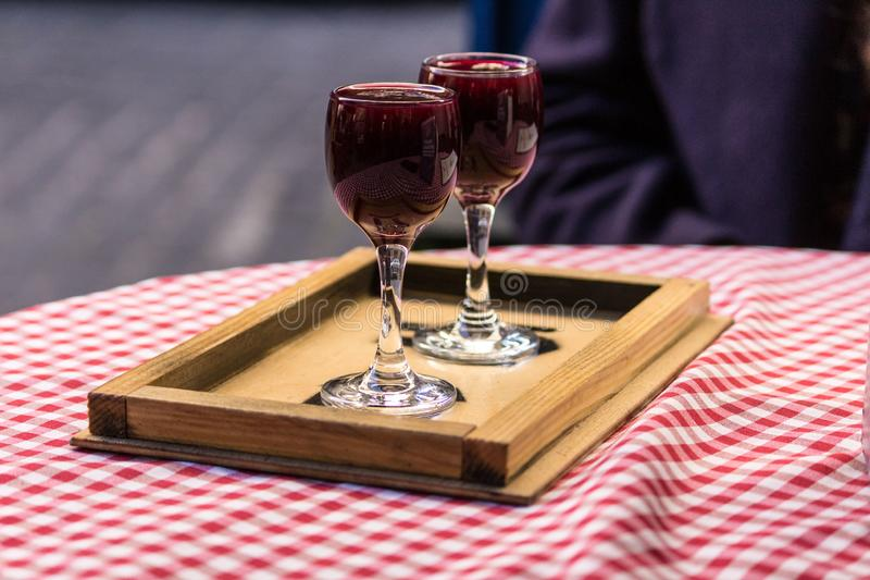 Two glasses of wine on the table. Two glasses of wine are on a stand on the table royalty free stock photography