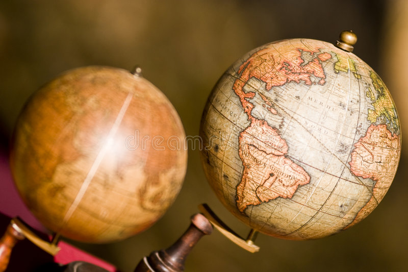 Two globes. Closeup on two atlas globes on a stand - Focus on the globe on the right stock photography
