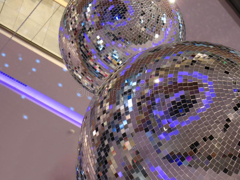 Two Glossy Disco Balls indoor. Reflecting lights background decorating glass mirror balls stock illustration