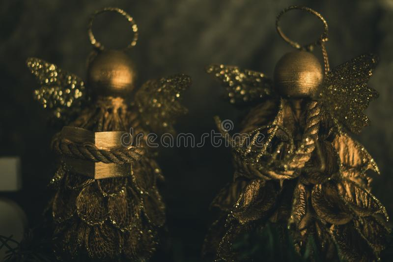 Two Gold-colored Christmas Decorations stock image