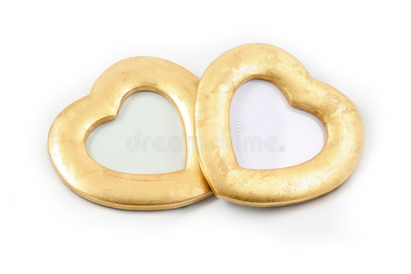 Two gold hearts. Can also be used as frames royalty free stock images