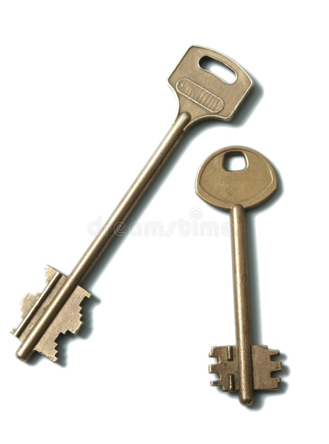 Two gold keys on a white background royalty free stock image