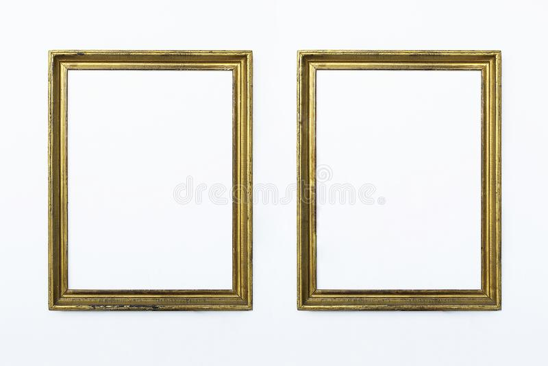 Two gold rectangular frames for painting or picture on white background. Isolated. Add your text. royalty free stock photos