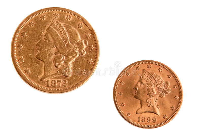 Two gold US coins twenty and ten dollars. royalty free stock photo