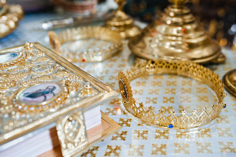 Two gold wedding crowns. At the church stock images