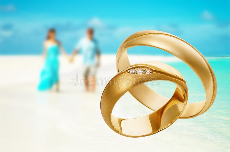 Two gold wedding rings with copy space. Concept on the theme of travel during the honeymoon. Photograph of jewelry made by. Two gold wedding rings with copy royalty free stock image