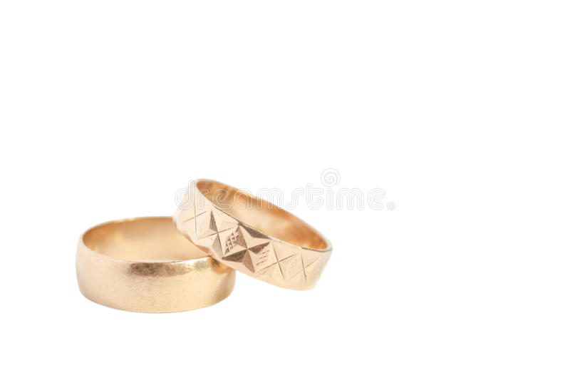 Two gold wedding rings isolated on white royalty free stock images