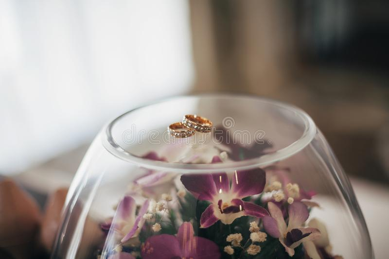 Two wedding rings on vase royalty free stock photo
