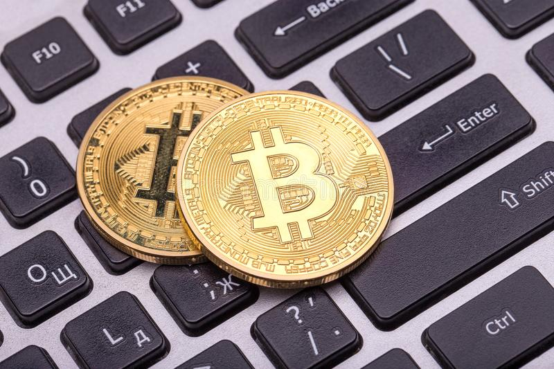 Two golden bitcoin royalty free stock images