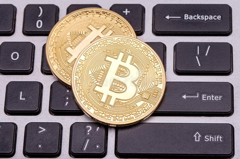 Two golden bitcoin royalty free stock photography