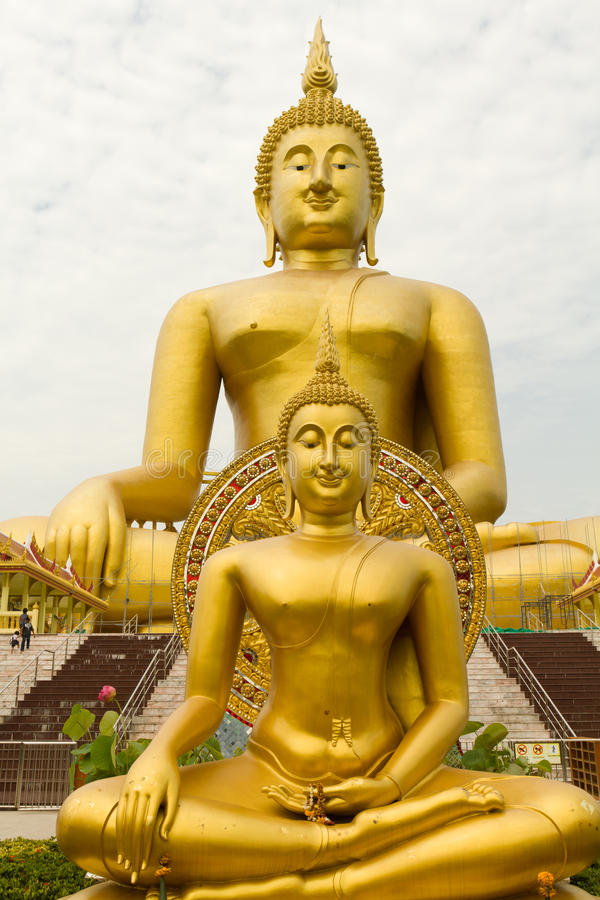 Two golden buddha stock photo