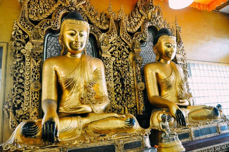 Two golden Buddha statues at Shwedagon Pagoda in Yangon. stock photography