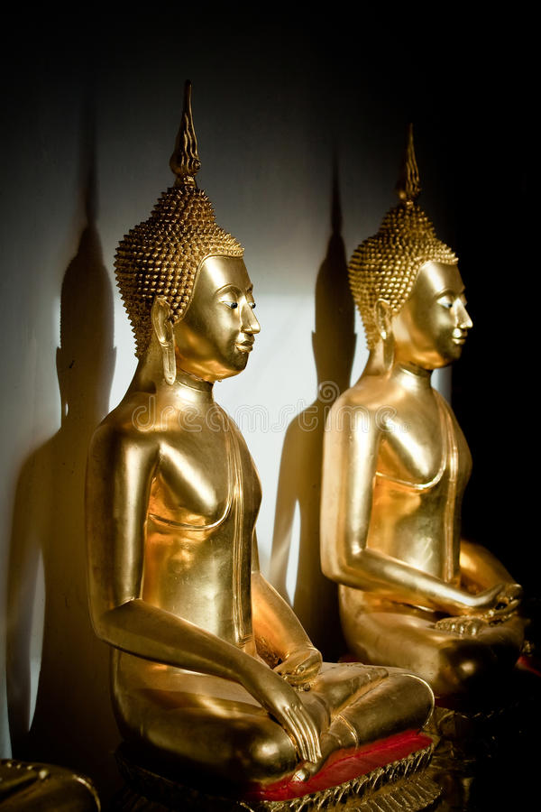 Two golden Buddha stock photography