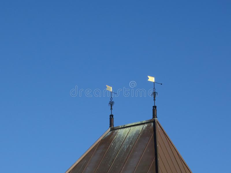 Two golden flags on top of a roof. In Schagen Netrherlands stock image