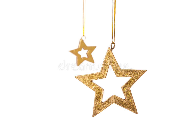 Two golden stars christmas decoration. All on white background royalty free stock photos