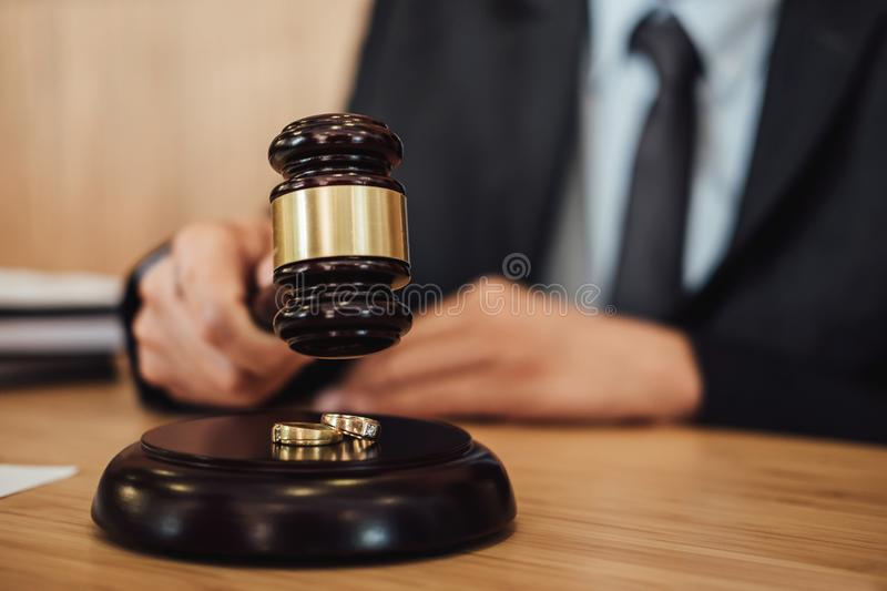 Two golden wedding ring on gavel, Marriage divorce on Judge gave. L deciding stock photos