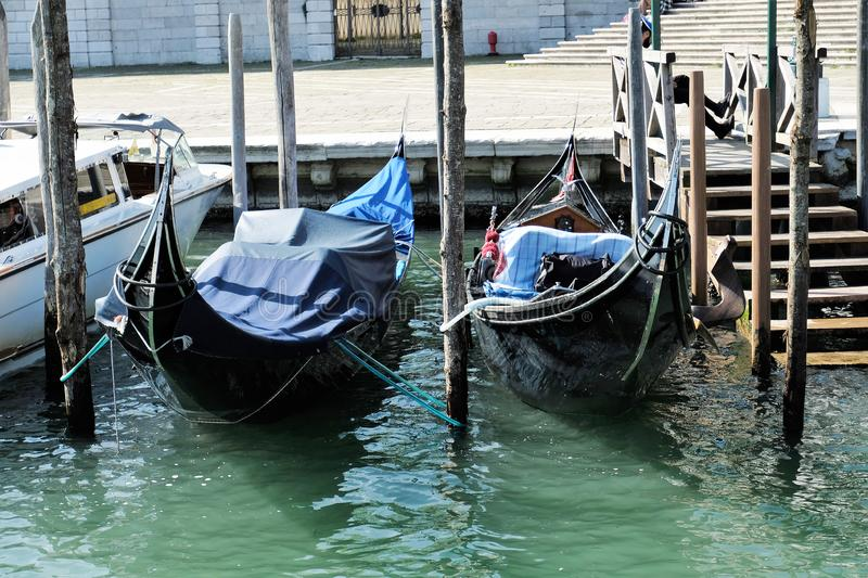 Two gondolas moored on Grand Canal in VEnice, Italy stock photos